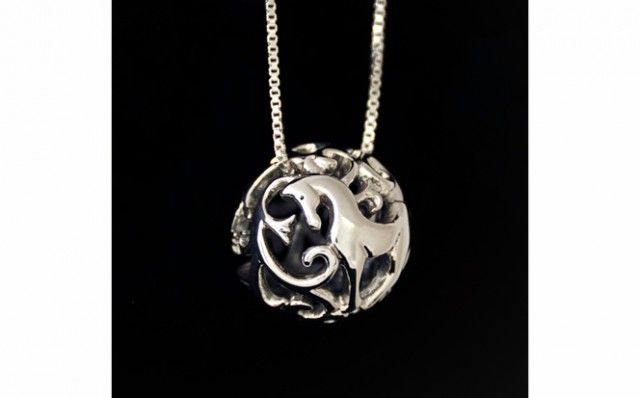 Photograph of sterling silver filigree horse necklace