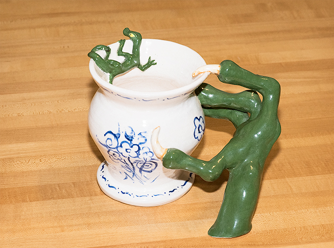 Vase with a claw reaching for a lizard