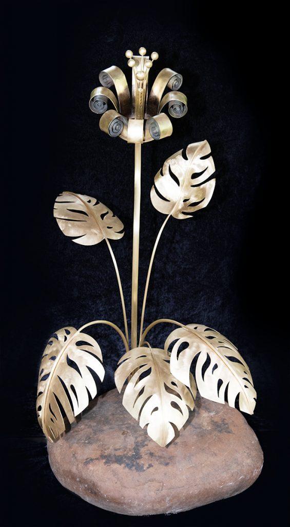 Artillery art sculpture of a flower sculpted from 105 Shell