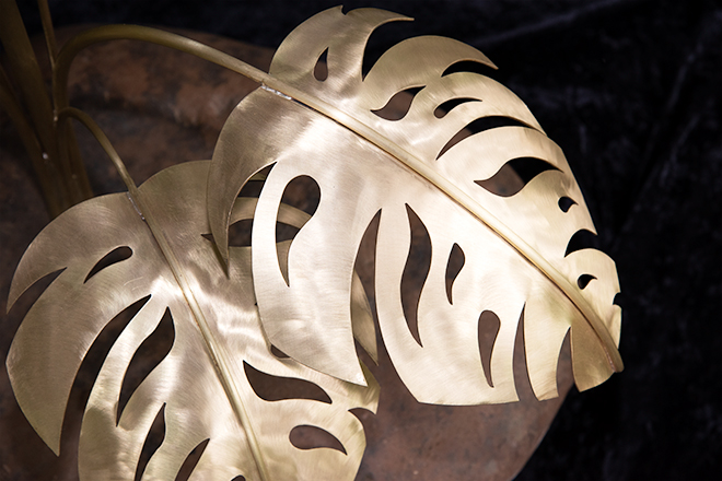 Brass leaves on a flower sculpture by Jeni Benos