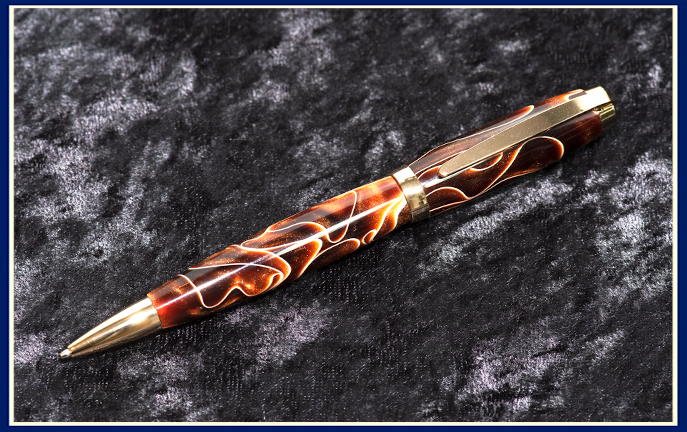 Hand turned pen in brown and gold acrylic by Phil Benos