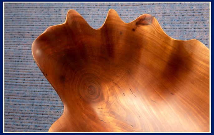 close up burl in artisan bowl carved in cherry wood