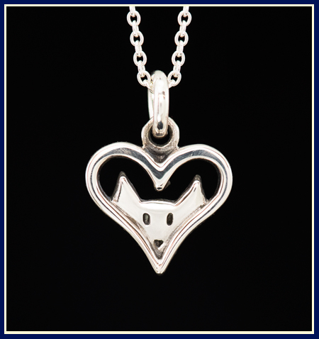 sterling silver necklace with a cat looking through an open heart