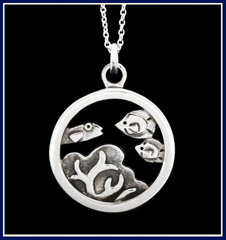Sterling silver necklace with fish and coral in a circle