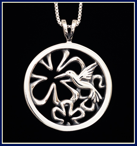 Sterling silver necklace with a humming bird and flowers in a circle