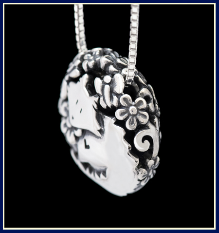 Filigree cat necklace in sterling silver side view with flowers