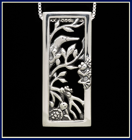 Handmade sterling silver pendant with animals hiding in mangroves