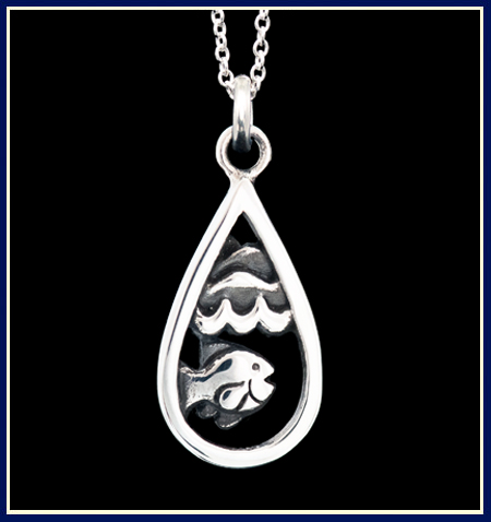 Silver necklace with a smiling fish under waves