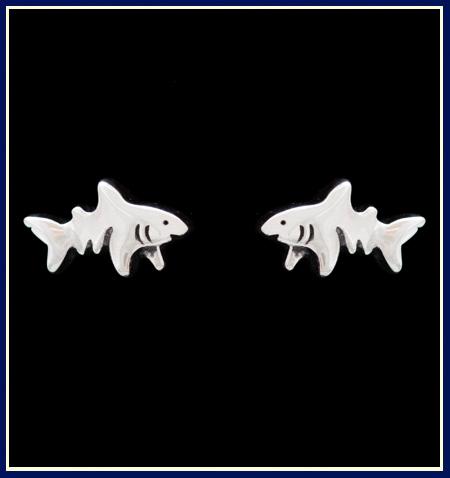 A pair of sterling silver shark stud earrings by Jeni Benos